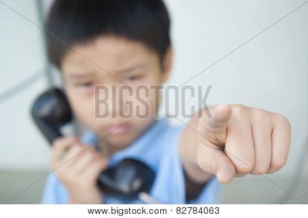 Focus Hand Of Boy Using Public Phone