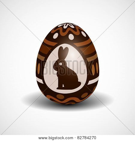 chocolate Easter egg with ornament and rabbit
