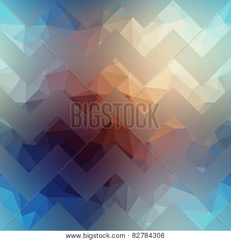Textured chevron pattern on blurred background.