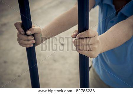 Boy Hands Holding The Iron Bar