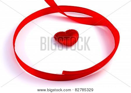 Red Tape Loop With Small Heart On A White Background