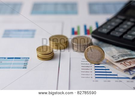 One Euro Coin On Paper Sheets With Charts
