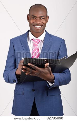 Black Businessman Wearing Suit And Tie Smiling