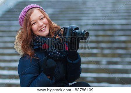 Joyful Beauty Young Woman Having Fun In Winter Park. Girl With A Camera