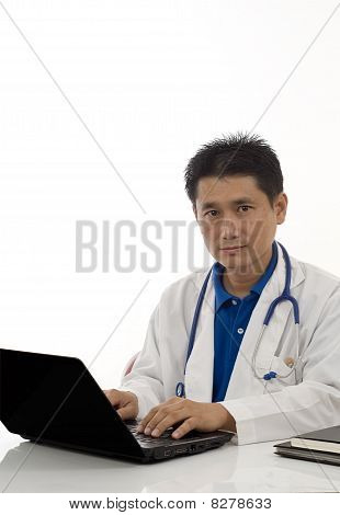 Doctor At His Desk