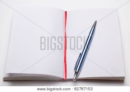 Open Note Book With Empty Pages With Pen