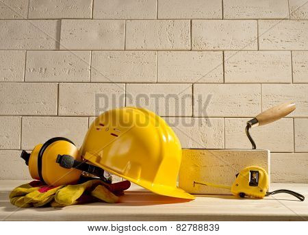 Brick Background, Helmet And Measuring Tape