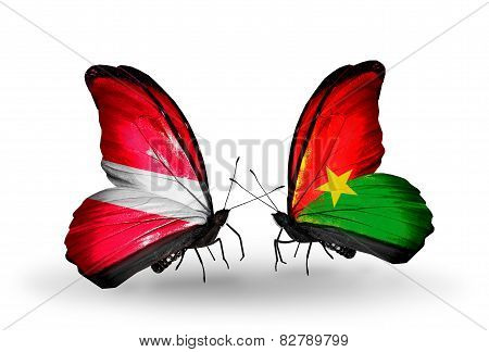 Two Butterflies With Flags On Wings As Symbol Of Relations Latvia And Burkina Faso