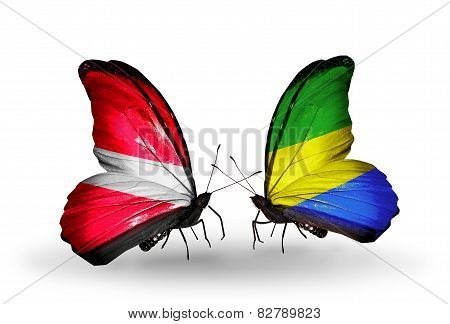 Two Butterflies With Flags On Wings As Symbol Of Relations Latvia And Gabon