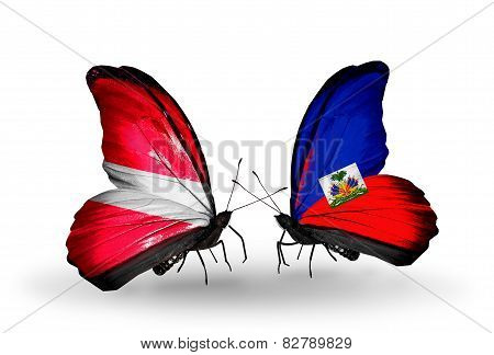 Two Butterflies With Flags On Wings As Symbol Of Relations Latvia And Haiti