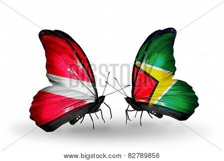 Two Butterflies With Flags On Wings As Symbol Of Relations Latvia And Guyana