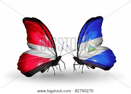 Two Butterflies With Flags On Wings As Symbol Of Relations Latvia And Nicaragua