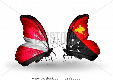 Two Butterflies With Flags On Wings As Symbol Of Relations Latvia And Papua New Guinea