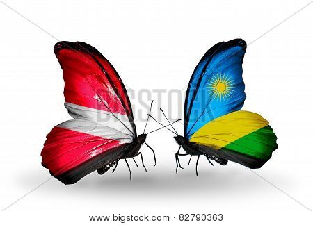 Two Butterflies With Flags On Wings As Symbol Of Relations Latvia And Rwanda
