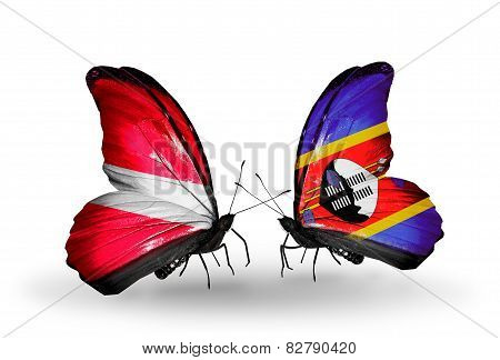 Two Butterflies With Flags On Wings As Symbol Of Relations Latvia And Swaziland