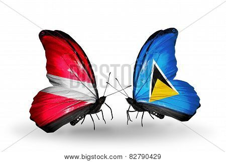 Two Butterflies With Flags On Wings As Symbol Of Relations Latvia And Saint Lucia