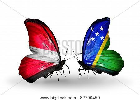 Two Butterflies With Flags On Wings As Symbol Of Relations Latvia And Solomon Islands