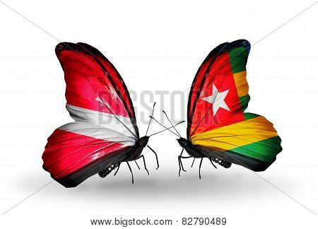 Two Butterflies With Flags On Wings As Symbol Of Relations Latvia And Togo