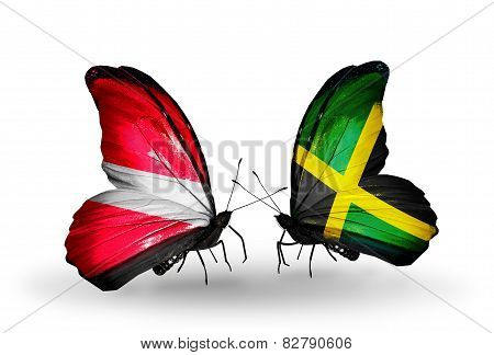 Two Butterflies With Flags On Wings As Symbol Of Relations Latvia And Jamaica