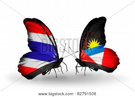 Two Butterflies With Flags On Wings As Symbol Of Relations Thailand And Antigua And Barbuda