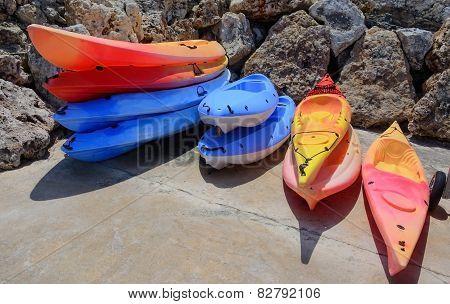 Stacks Of Colorful Kayaks