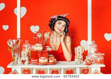 Girl In A Stall With Cakes And Sweets.
