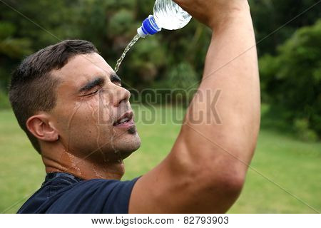 Fitness Man Cooling Down With Water