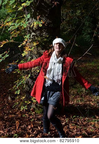Girl laughing in the autumn woods