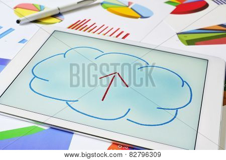 a drawing of a cloud with an arrow inside on the screen of a tablet, depicting the concept of upload to the cloud storage