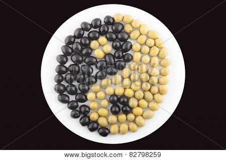 Yin and Yang made of green and black olives