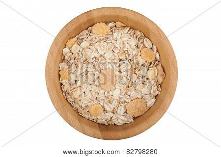 Oat and corn flakes in wooden bowl