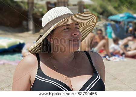 Summer Portrait Of Young Woman Wearing Straw Hat.
