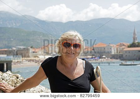 Portrait Of Aged Lady On The Resort Background.