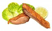 stock photo of duck breast  - Two roasted duck breasts with lettuce leaves isolated on a white background - JPG