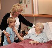 foto of hospice  - family visiting grandmother in hospice - JPG