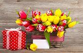 stock photo of gift basket  - spring tulips in wooden basket red polka - JPG