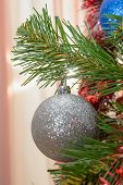 stock photo of view from space needle  - Christmas decorations hanging on a pine tree with glitter sparkle scintillation - JPG