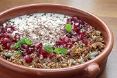 picture of pomegranate  - Bowl of granola with pomegranate seeds and yogurt - JPG