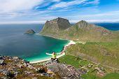 foto of lofoten  - Sporty woman on the top of a mount Holandsmelen Lofoten Norway  - JPG