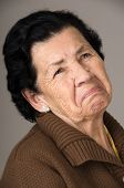 picture of grandmother  - closeup portrait of old cranky grumpy sad woman grandmother - JPG