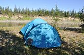 pic of ural mountains  - Camping tent on the shore of a mountain river - JPG