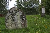 foto of tombstone  - Tombstone on a ruined graveyard in Sweden.