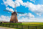 pic of water-mill  - View of beautiful old wooden water pumping windmill for arrogation in Molendjik - JPG