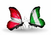 picture of nigeria  - Two butterflies with flags on wings as symbol of relations Latvia and Nigeria - JPG