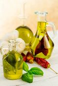 picture of flavor  - oil bottles flavored with herbs and spices - JPG