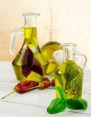 stock photo of flavor  - oil bottles flavored with herbs and spices - JPG