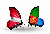 stock photo of eritrea  - Two butterflies with flags on wings as symbol of relations Latvia and Eritrea - JPG