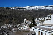 stock photo of snow capped mountains  - General view over town rooftops towards the snow capped mountains Bubion Las Alpujarras Granada Province Andalusia Spain Western Europe - JPG