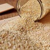 picture of quinoa  - quinoa seeds coming out from a glass jar - JPG
