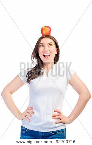 Funny Girl With Apple On Her Head On A White Background